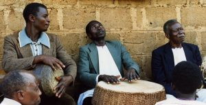 Evaristo Muyinda at home with friends, 1987
